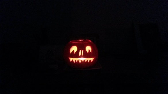Image shows a jack o' lantern against a black background.
