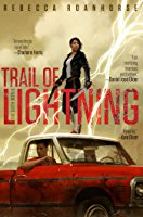 Image shows the cover of Trail of Lightening which features a young woman dressed in black standing on stop of a red car driven by a young man. She holds a gun and lightening plays around her.