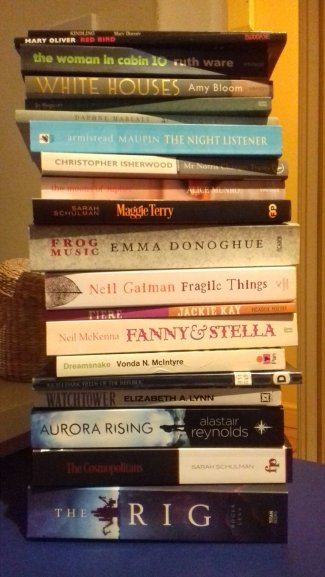 A pile of 20 books stacked on top of one another, a mixture of novels and poetry collections (list below)