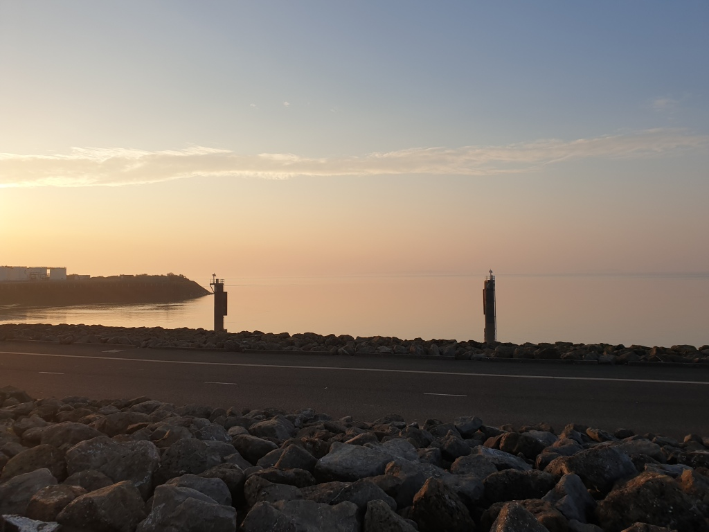 A view from Cardiff Bay barrage looking out towards the Bristol channel on a clear morning