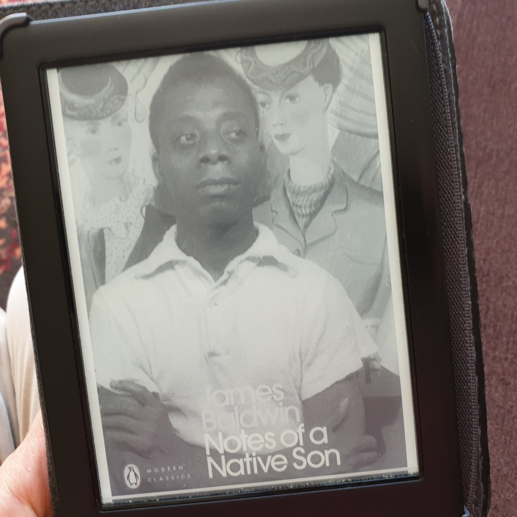 A e-reader with a picture of the cover of Notes of a Native Son. It shows a black and white photograph of the author as a young man wearing a white shirt with his arms crossed.